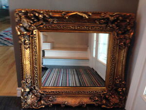mirror with golden decorative frame