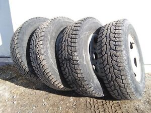 Studded winter tires 235-75R-16