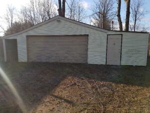 HEATED DOUBLE GARAGE WITH STORAGE 500 SQUARE FEET