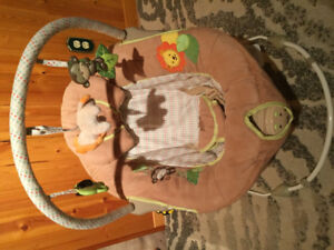 Musical bouncer baby chair