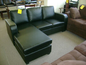 New black sofa with lounger. On Sale $499.