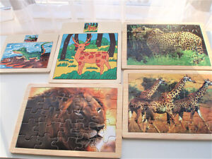 5 PUZZLES - SOLID WOOD BASE - AS NEW