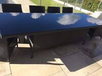 Black rattan garden table with new glass top