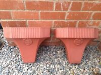 Terracotta coloured plastic wall planters