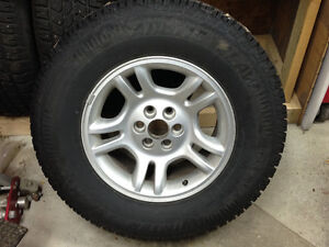 Set of 4- 255/70R16 Arctic Claw Winter Tires with rims