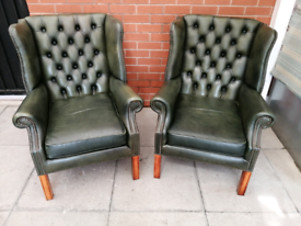 A Pair Of Green Leather Chesterfield Armchairs