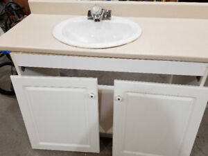 Vanity with sink and mirror