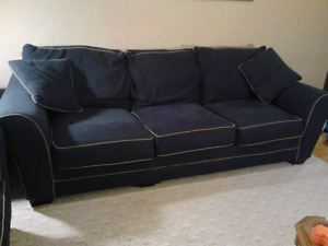 couch and loveseat with matching throw cushens