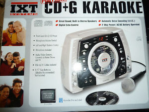 Unopened Karaoke machine with mike