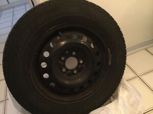 Set of 4 used Good Year Ultra Grip winter tires with rims