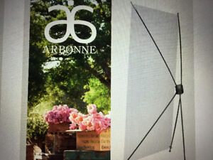 Arbonne banner with stand and table cloth runner.