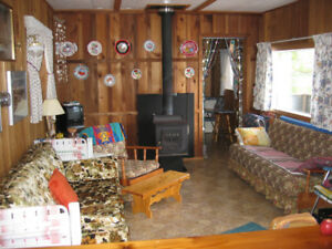 float house for sale on Great Central Lake bc