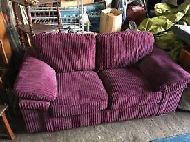 Beautiful purple 2 seater sofa
