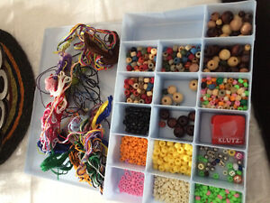 Craft container full of beads and string