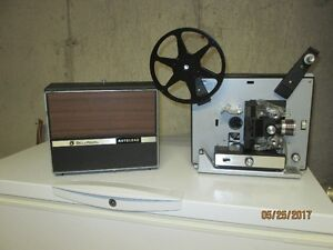 Movie projector and tripod viewing screen