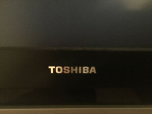 Toshiba 60 inch TV rear projector- Including Glass TV stand.