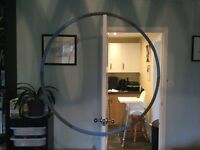 Weighted hula hoop, foam padded, comes apart for easy storage and transport