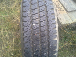 one 235/ 85 r / 16 tire mounted on a ford rim like new for wear