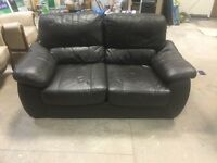 X2 brown leather sofas