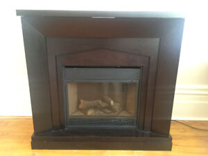 Dark Brown electric fireplace. Provides heat or just fire.