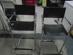 pair of chrome counter stools or bar stools