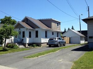 FULLY UPDATED 1 1/2 STOREY WITH DETACHED GARAGE