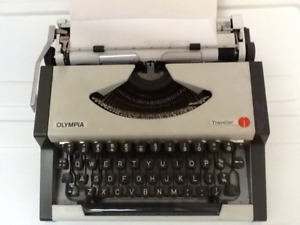 Vintage 1970s Olympia Traveller portable typewriter