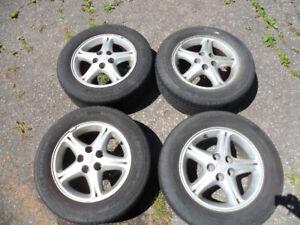 """Nissan Michelin 16"""" Tires & Rims 215/60R16 Premier A/S"""