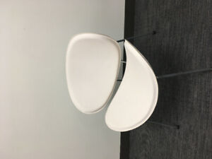Two ikea curved white chairs