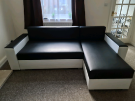 Corner sofa bed with storage and sleeping function.