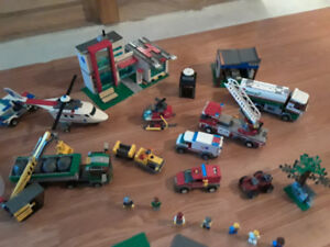 Lego sets, parts, mini figures, base plates, and instructions