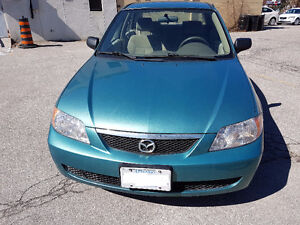 2002 Mazda protege with E-test&safety Low mileage 60222.