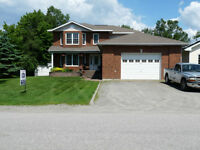 ** A MAJESTIC  2 STOREY,  4 BEDROOM,  BRICK, WATERFRONT HOME! **