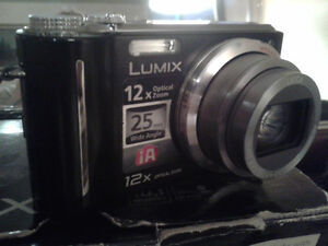 Panasonic Lumix DMC-ZS1 10MP Digital Camera + Accessories