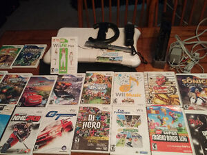 Wii complete with wii fit 20 games 2 numchuks and 2 steering whe