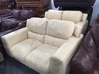 2 cream leather 2 seater sofas