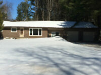 Loads of living space. Steps from Muskoka River. Huge yard.