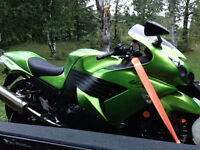 2009 zx14 25k on it new tires 5900 $ might trade for good sled