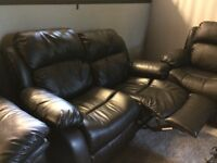 Black leather reclining love seat