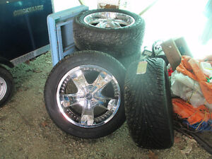 20 inch crome rims & tires new cond. trade for outboard. 5 bolt.