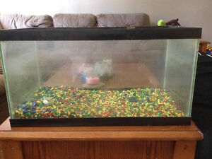 Tank with gravel for sale.
