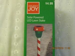 Holiday solar powered LED lawn stakes