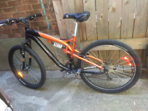Kranked mountain bike with dual suspension