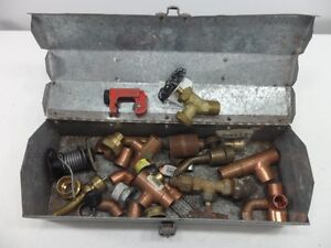 Plumbing Supplies and Pipe Cutter in Metal Toolbox