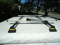 Roof top bike/canoe carrier for camping tent trailer