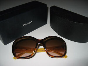 02308183c4 Prada Sunglasses - Women s