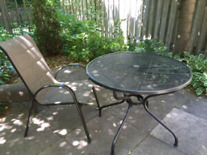 Table: Patio, round, steel mesh, perfect condition.