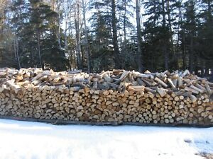 Seasoned Hardwood Firewood. cut, split and delivered.