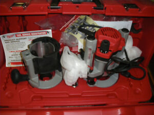 New Milwaukee heavy duty dual base  router kit and case .