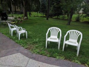 Set of 4 white plastic patio chairs
